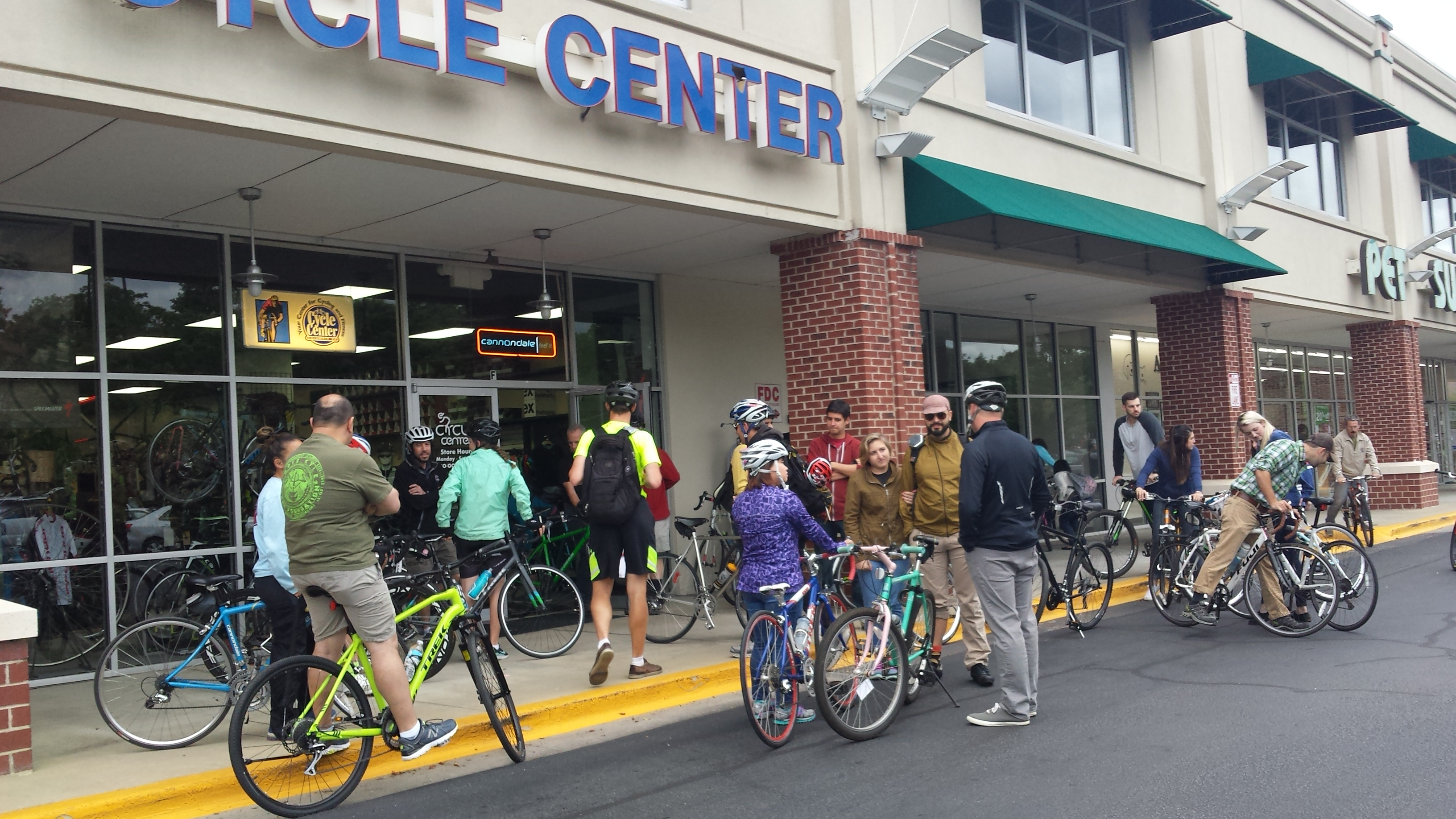 Photo of cyclists gathered at Cycle Center waiting to start a group ride